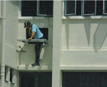 man on phone, whilst instaling a aircon
