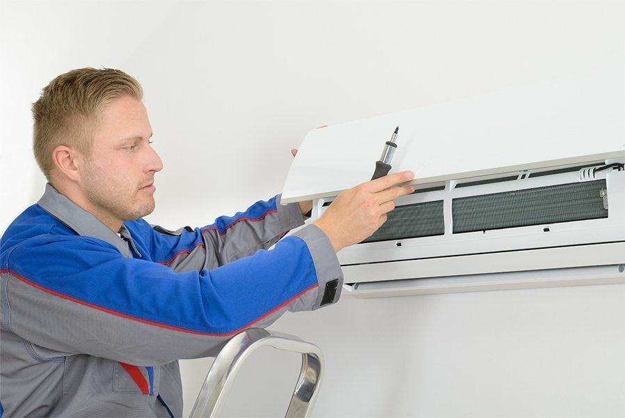 The air conditioning company fixed installations portable air con air conditioning company engineer servicing a wall mounted air conditioner in london sciox Gallery