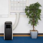 Airconco Arctic portable air conditioner in an office white and dark brown case, hose going out window