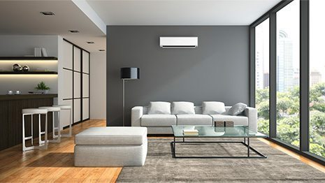 White Wall-Mounted Air conditioning unit in a modern lounge