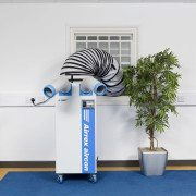 Airrex HSC2500 installed in an Office with exhaust hose out the window